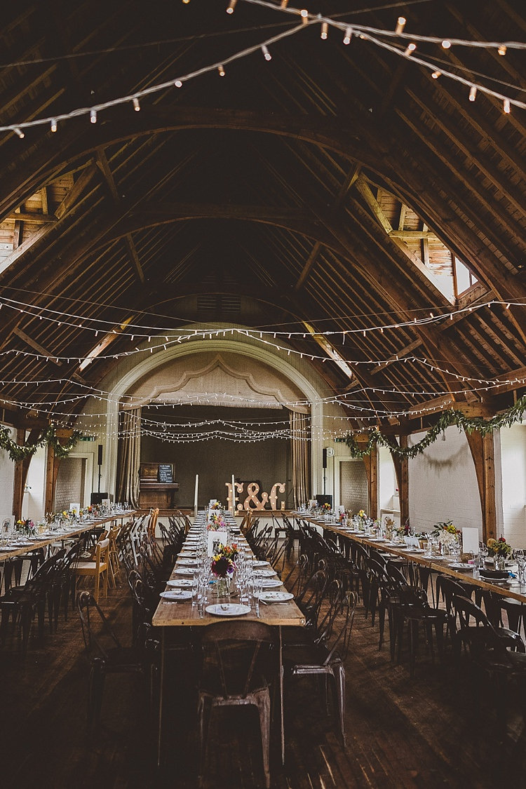 FAiry Lights Rustic Industrial Table Chairs Decor Eclectic Whimsical Village Hall Wedding http://www.nicolacasey.photography/