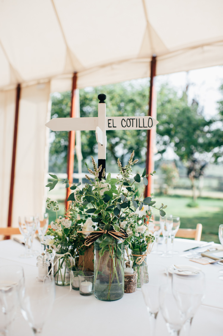 Centrepiece Flowers Jars Decor Sign Post Travel Place Seaside Country Farm Pale Blue Marquee Wedding http://loveandadventures.co.uk/