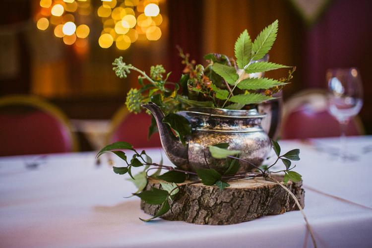 Tea Pot Foliage Centrepiece Decor Log Relaxed Autumnal Child Friendly Wedding http://kathrynedwardsphotography.com/