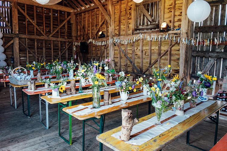 Ribbon Bunting Wild Flowers Bottles Tables Decor Fun DIY Barn Farm Summer Wedding http://www.annapumerphotography.com/
