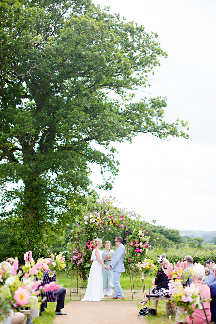 Outdoor Ceremony UK Arch Flowers Colourful Pastel Home Made Farm Wedding http://helencawtephotography.com/