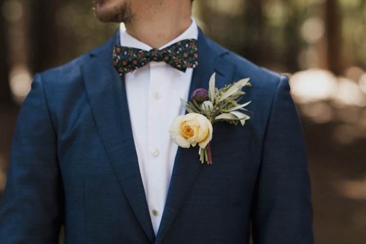 Groom Dark Blue Suit White Shirt Patterned Bowtie Floral Buttonhole Yellow Rose Greenery Whimsical Forest Harry Potter Wedding http://heatherelizabethphotography.com/