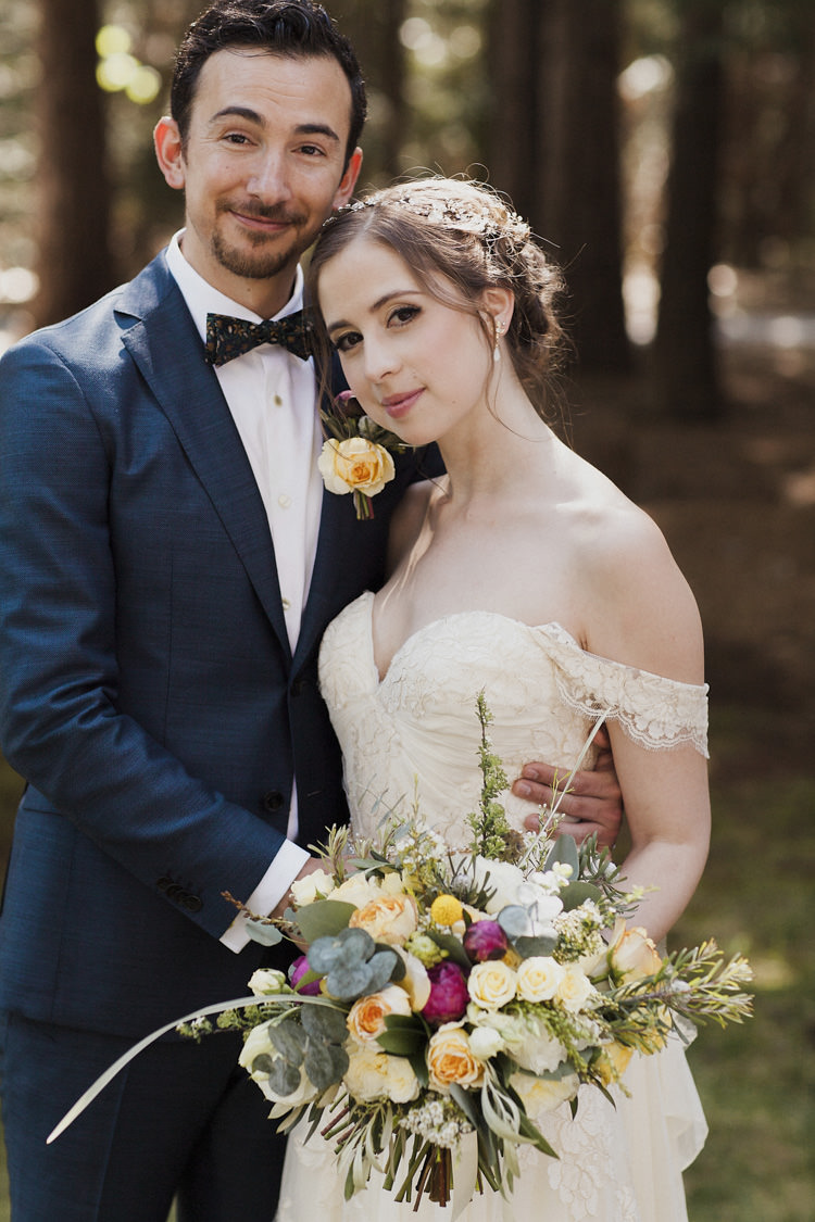 First Look Bride Sarah Seven Cascade Lace Off The Shoulder Bridal Gown Crystal Hairpiece Multicoloured Bouquet Cream Yellow Pink Green Roses Peonies Groom Dark Blue Suit Patterned Bowtie Floral Buttonhole Whimsical Forest Harry Potter Wedding http://heatherelizabethphotography.com/