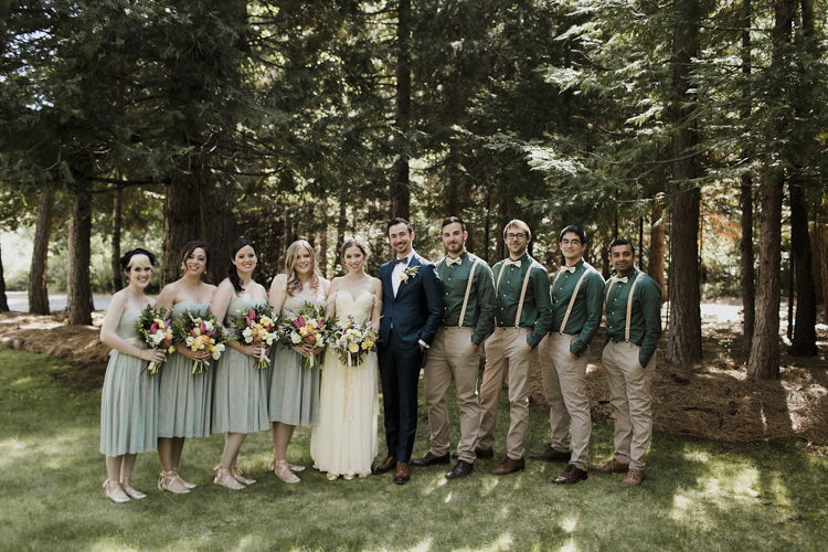 Bridal Party Bride Lace Off The Shoulder Bridal Gown Groom Dark Blue Suit Patterned Bowtie Bridesmaids Green Strapless Dresses Groomsmen Green Shirts Beige Pants Suspenders Bowtie Whimsical Forest Harry Potter Wedding http://heatherelizabethphotography.com/