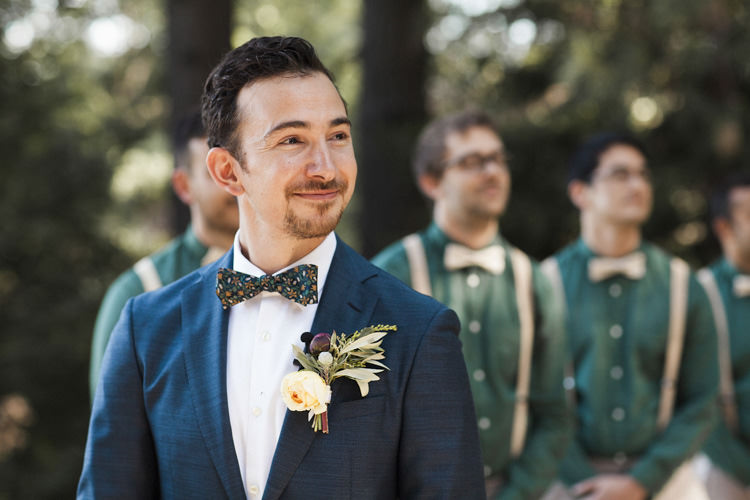 Outdoor Ceremony Groom Dark Blue Suit White Shirt Patterned Bowtie Floral Buttonhole Groomsmen Green Shirts Beige Suspenders Bowties Whimsical Forest Harry Potter Wedding http://heatherelizabethphotography.com/