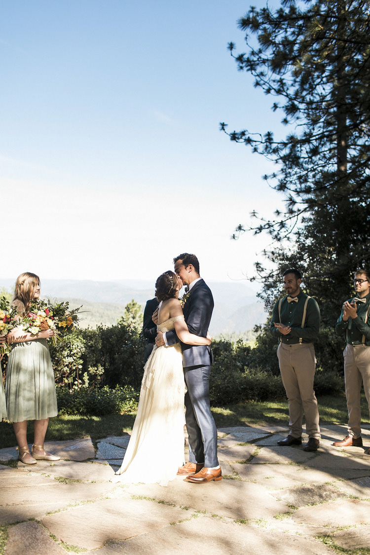 Outdoor Ceremony Bride Sarah Seven Cascade Lace Off The Shoulder Bridal Gown Crystal Hairpiece Groom Dark Blue Suit Patterned Bowtie Floral Buttonhole Bridesmaids Groomsmen Whimsical Forest Harry Potter Wedding http://heatherelizabethphotography.com/