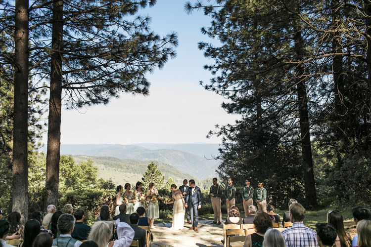 Outdoor Ceremony Bride Sarah Seven Cascade Lace Off The Shoulder Bridal Gown Crystal Hairpiece Groom Dark Blue Suit Patterned Bowtie Floral Buttonhole Bridesmaids Groomsmen Guests Whimsical Forest Harry Potter Wedding http://heatherelizabethphotography.com/