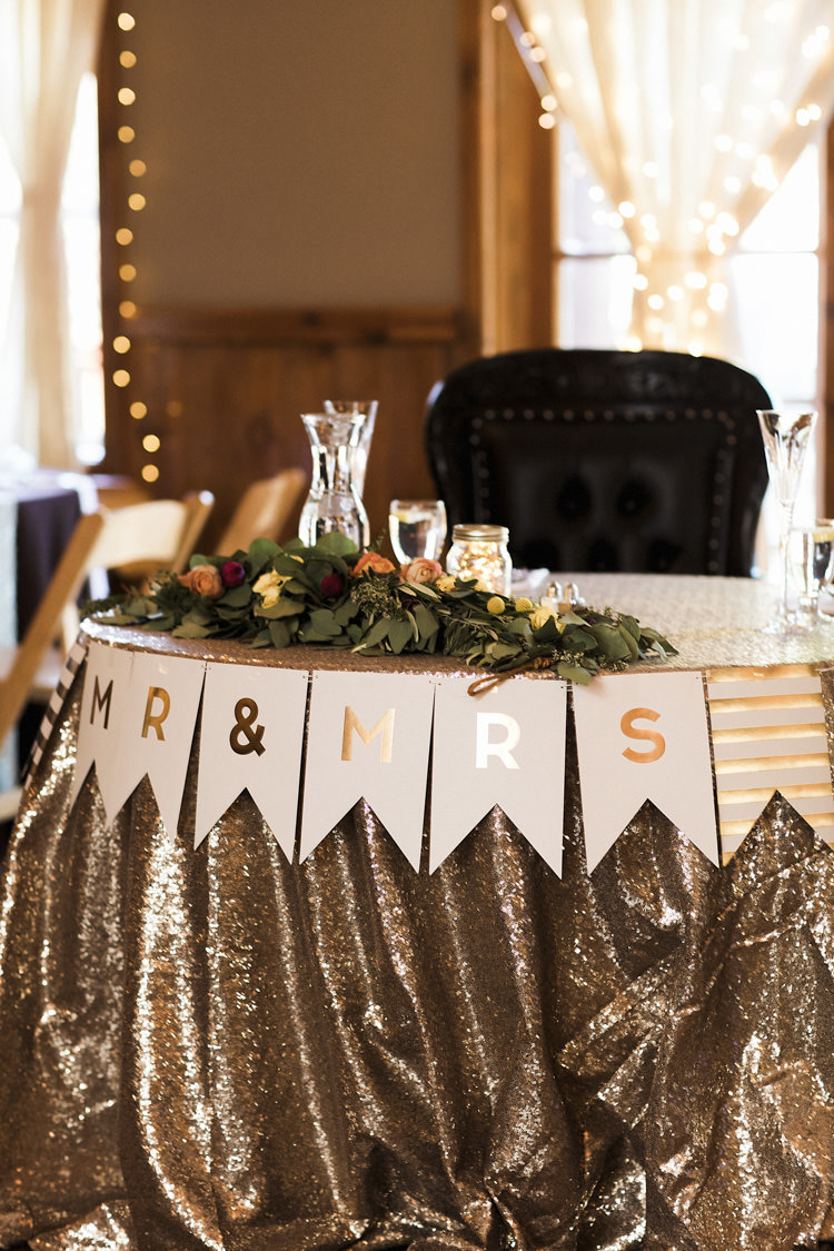 Reception Table Setting Bride Groom Table Metallic Sequin Tablecloth Mr Mrs Bunting Multicoloured Florals Greenery Vintage Chairs Whimsical Forest Harry Potter Wedding http://heatherelizabethphotography.com/