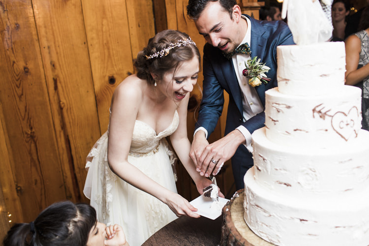 Reception Cake Cutting Bride Sarah Seven Cascade Lace Bridal Gown Crystal Hairpiece Groom Dark Blue Suit Patterned Bowtie Floral Buttonhole Whimsical Forest Harry Potter Wedding http://heatherelizabethphotography.com/