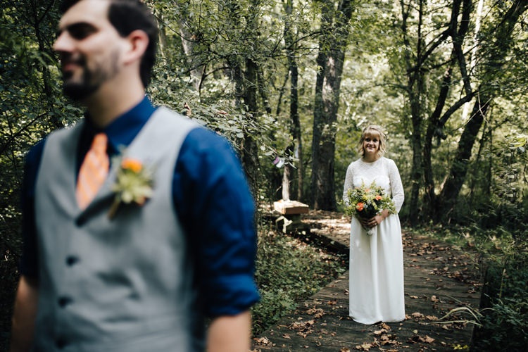 Outdoor First Look Bride Handmade Lace Floral Belt Bridal Gown Bouquet Groom Grey Vest Navy Blue Shirt Orange Checkered Tie Buttonhole Orange Florals Succulent Adventure Inspired Woodland Wedding North Carolina http://www.amandasuttonphotography.com/