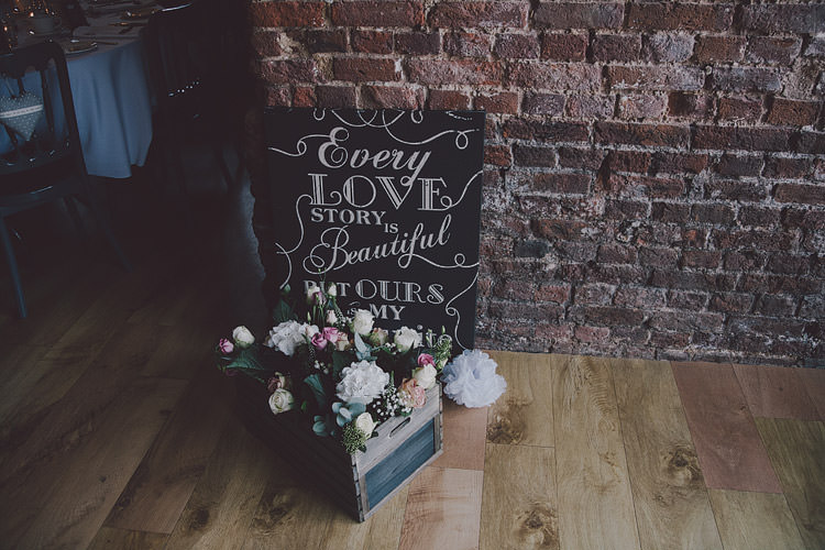 Chalk Black Board Sign Crate Flowers Chic Rustic Grey Barn Wedding http://www.kevelkinsphotography.co.uk/