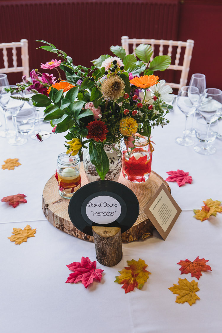 Colourful Floral Centrepiece Record Table Name Relaxed Cosy Stylish Autumnal Wedding http://www.tierneyphotography.co.uk/