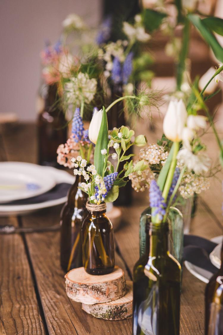 Bottle Flowers Logs Decor Magical Spring Bluebell Woodland Wedding Ideas http://helinebekker.co.uk/
