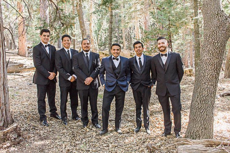 Groom Dark Blue Suit Black Satin Lapel Black Pants Black Bowtie Groomsmen Black Suits Black Bowties Ties DIY Whimsical Camp Wedding California http://www.landbphotography.org/
