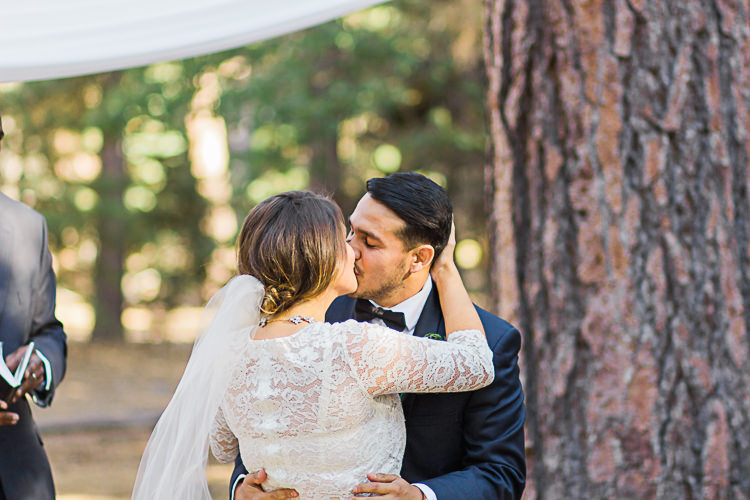 Outdoor Ceremony Bride Watters Separates Lace Top Tulle Skirt Veil Groom Dark Blue Jacket Black Satin Lapel Black Bowtie Kiss DIY Whimsical Camp Wedding California http://www.landbphotography.org/