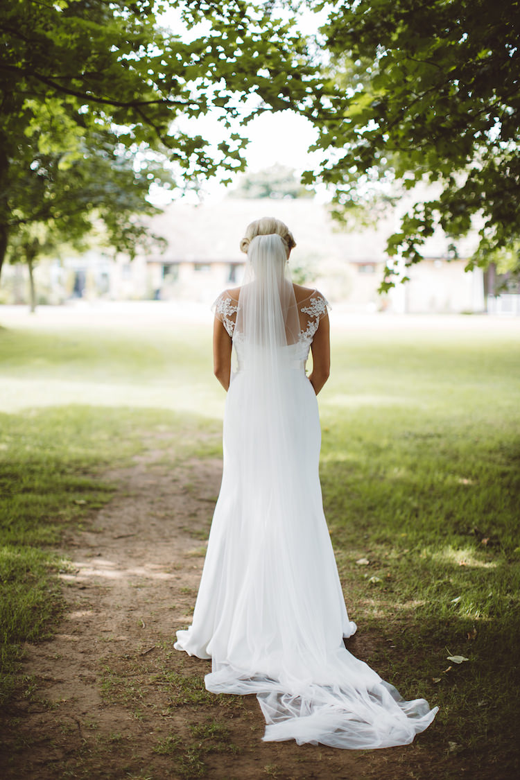 Mayfair by Suzanne Neville Dress Gown Bride Bridal Sleeves Veil Fishtail IllusionCotswolds Country House Marquee Wedding http://www.wearegatheredheretoday.com/