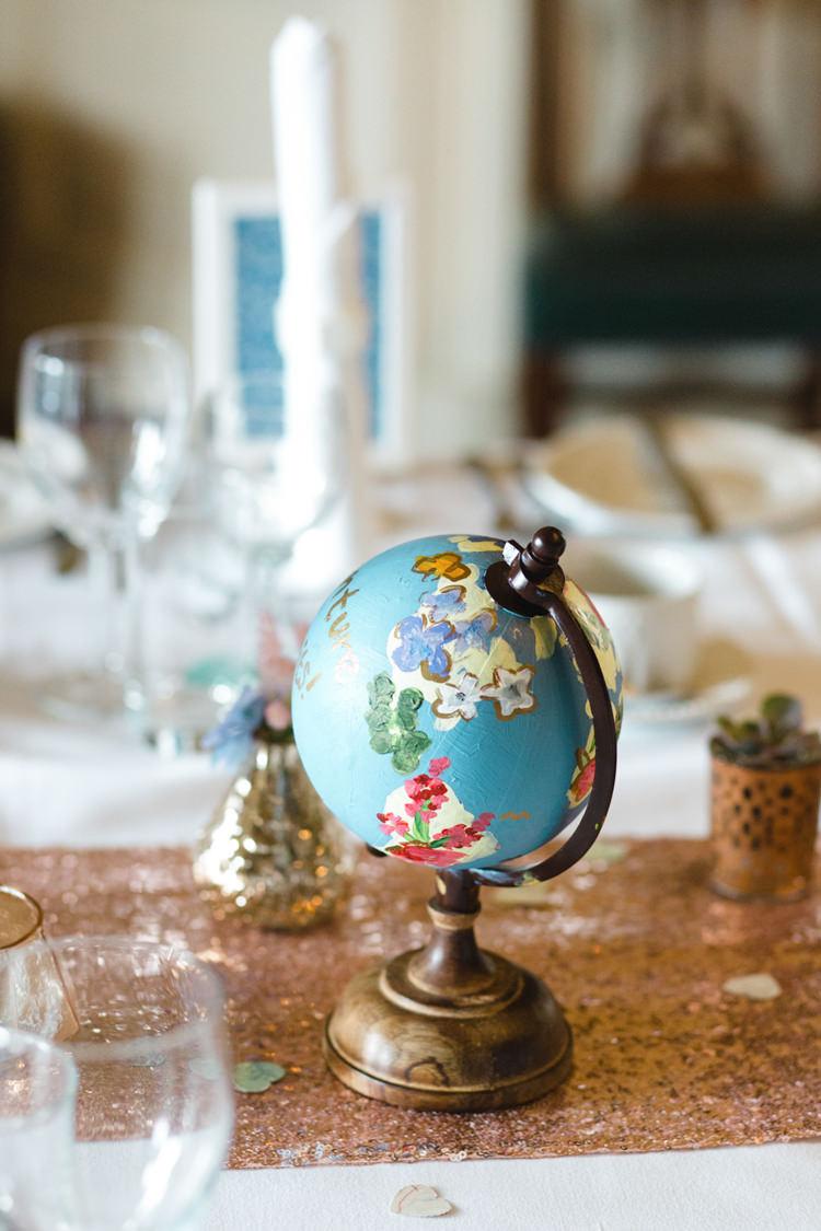Painted Globe Decor Whimsical Pastel Travel Wedding https://www.thegibsonsphotography.co.uk/