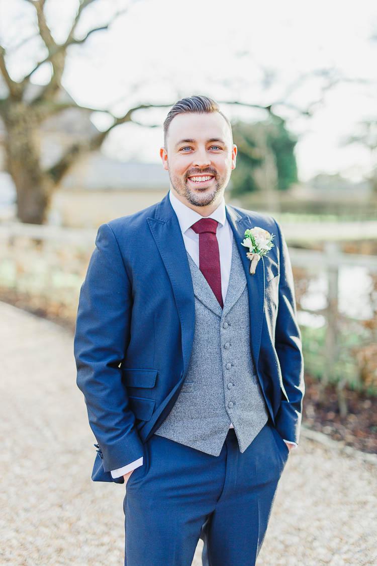 Blue Suit Groom Grey Waistcoat Red Tie Beautiful Rustic Fairy Lights Barn Wedding http://whitestagweddings.com/