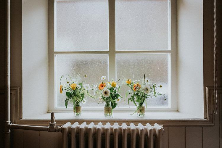 Flowers Jars Windowwill Radiator Collum Decor Stylish Hand Made Rainy Summer Barn Wedding http://www.kategrayphotography.com/