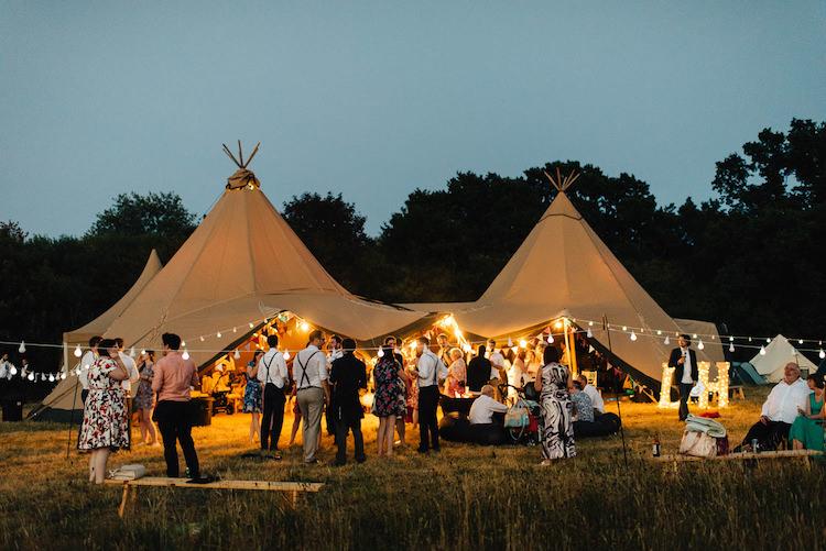 Tipi Festoon Lights Informal Camp Woodland Wedding https://stevenanthonyphotography.co.uk/