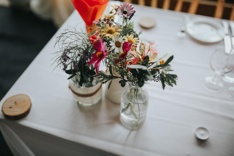 Jars Multicoloured Flowers Daisy Greenery Milk Bottles DIY Farm Weekend Long Wedding http://www.nestalloyd.co.uk/