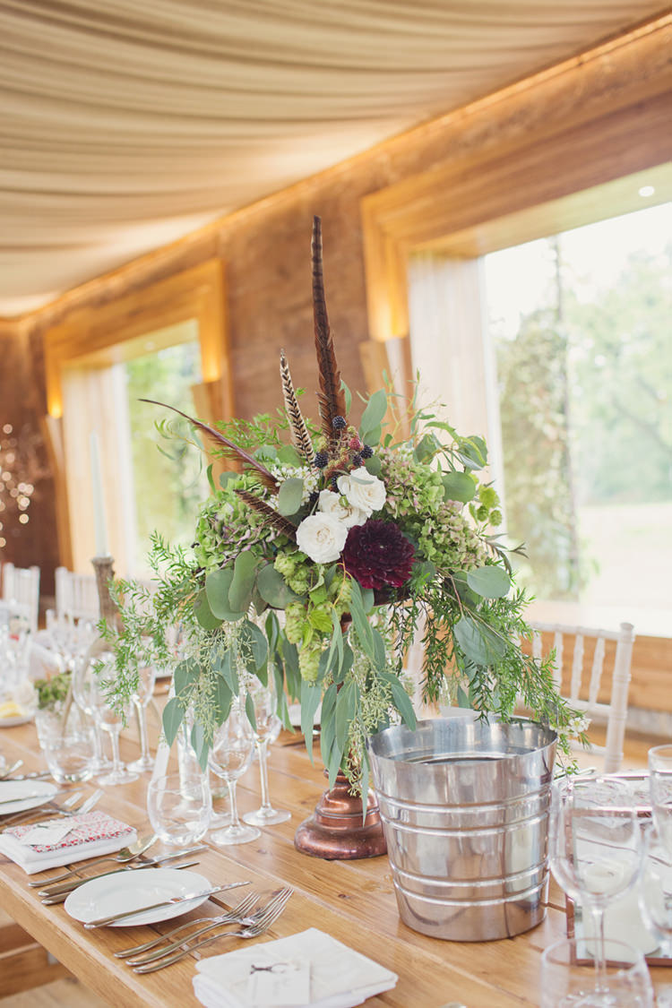 Red Burgundy Dahlia Blush Table Centrepiece Flowers Foliage Rose Antler Feather Stunning Countryside Wedding http://www.cottoncandyweddings.co.uk/