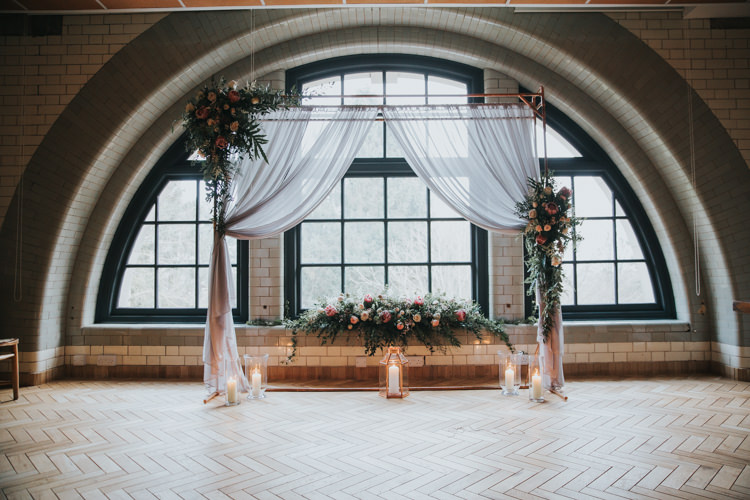 Arch Backdrop Flowers Fabric Candles Industrial Into The Wild Greenery Wedding Ideas http://www.ivoryfayre.com/