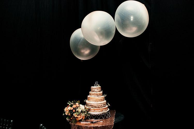 Naked Cake Giant Balloons Dark Black Draping Reception Decor Stylish Winter Glamour Wedding http://lunaweddings.co.uk/