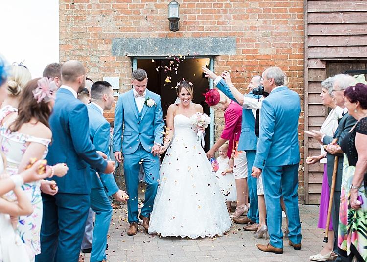 Confetti Shot Bride Bridal Lilian West Groom Next Romantic Soft Pastels Barn Wedding http://www.sungblue.com/