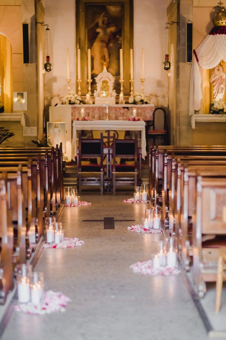 Church Aisle Petals Candles Ceremony Catholic Romantic Vibrant Pink Wedding Trieste http://www.emotionttl.com/en/home/