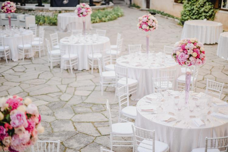 Tall Centre Pieces White Linen Tables Chairs Romantic Vibrant Pink Wedding Trieste http://www.emotionttl.com/en/home/