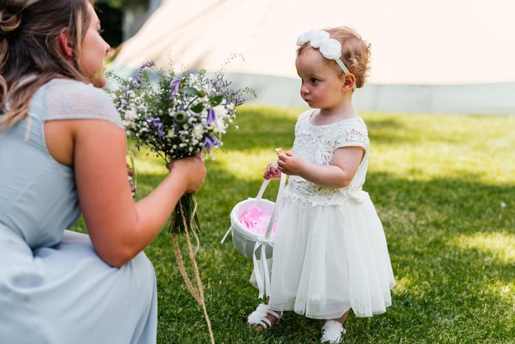 Flower Girl White Dress Petal Basket Fun Loving Secret Garden Tipi Wedding https://www.aaroncollettphotography.co.uk/