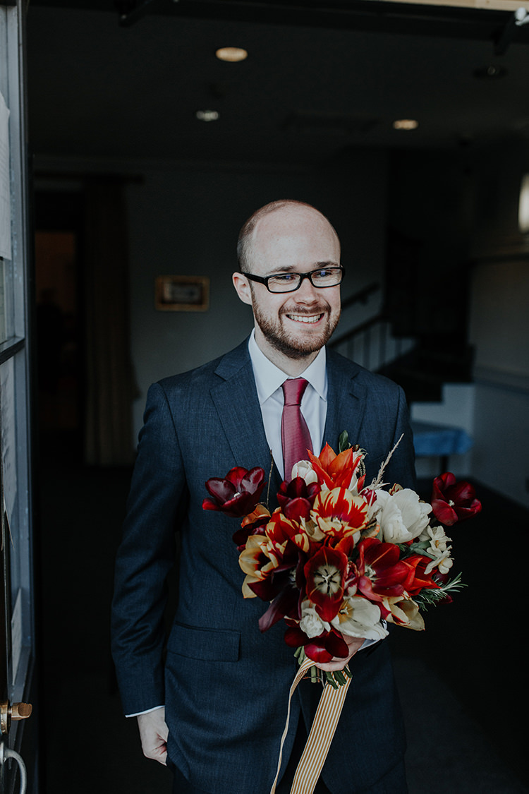 Groom Bouquet Tulips Red White Ribbon Flowers All The Colours Quirky Dinosaur Wedding https://leahlombardi.com/