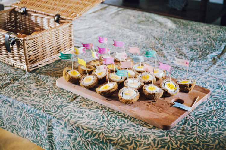 Canapes Scotch Eggs Flags Cocktail Sticks Relaxed Bohemian Spring Barn Wedding http://emilytylerphotography.com/