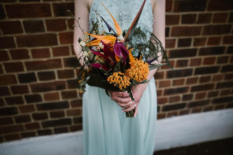 Bridesmaid Bouquet Flowers Orange Purple Tropical Bird Paradise Lily Laid Back Local London Lido Wedding http://andrewbrannanphotography.co.uk/