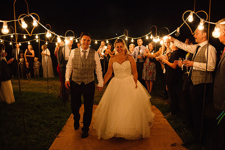 Festoon Lights Exit Bride Groom Charming Natural Countryside Tipi Wedding http://www.pauljosephphotography.co.uk/