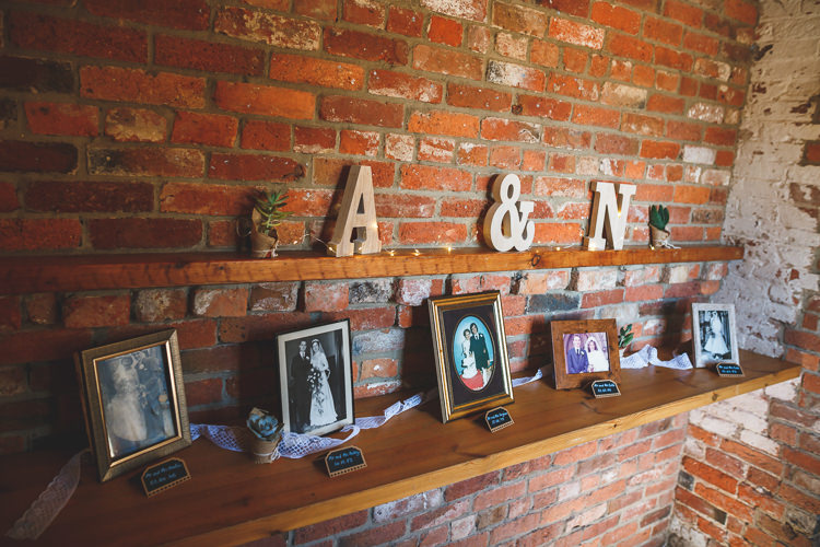 Wood Cut Letter Initial Family Photographs Fairy Lights Rustic Barn Red Gold Glam Wedding https://garethnewsteadphotography.com/