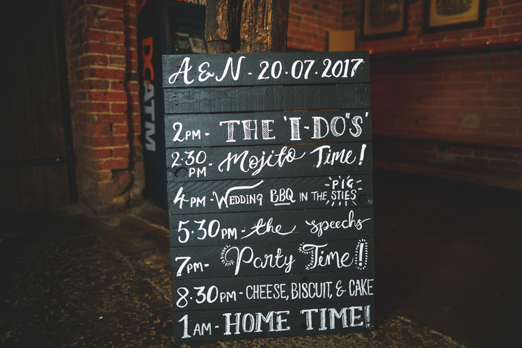 Order of Day Pallet Board Chalk Timetable Welcome Rustic Barn Red Gold Glam Wedding https://garethnewsteadphotography.com/