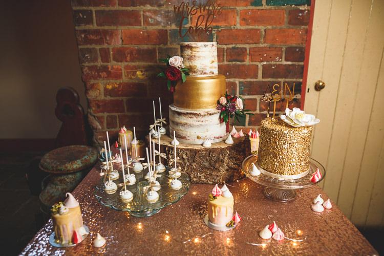 Cake Table Sequin Cloth Cake Pops Buttercream Naked Log Wood Slice Stand Meringue Kisses Fairy Lights Topper Laser Cut Rustic Barn Red Gold Glam Wedding https://garethnewsteadphotography.com/