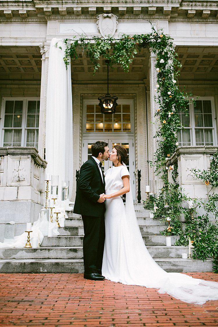 Bride Groom Kiss Black Tie Long Veil Short Sleeve Dress Plain Greenery Steps Candles Gold Modern Elegance Marble Greenery Gold Wedding Ideas http://www.jettwalkerphotography.com/