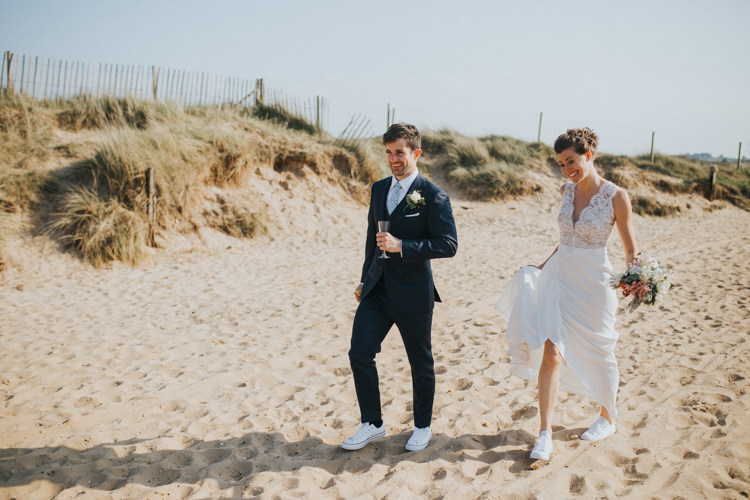 Bride Bridal Suzanne Neville Dress Gown Lace V Neck Suit Supply Groom Couples Portrait Trainers Beautifully Serene Beachside Barn Wedding https://joshuapatrickphotography.com/
