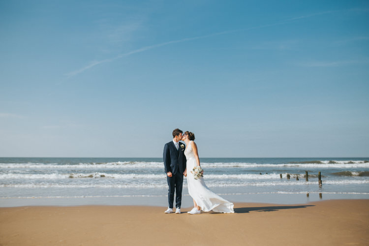 Bride Bridal Suzanne Neville Dress Gown Lace V Neck Suit Supply Groom Trainers Beautifully Serene Beachside Barn Wedding https://joshuapatrickphotography.com/