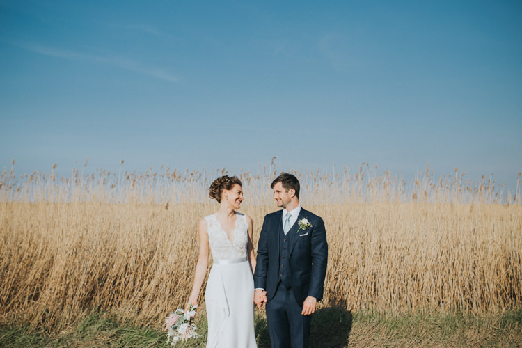Bride Bridal Suzanne Neville Dress Gown Lace V Neck Suit Supply Groom Beautifully Serene Beachside Barn Wedding https://joshuapatrickphotography.com/