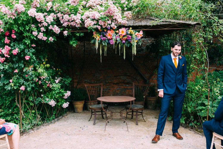 Navy Suit Yellow Orange Tie Groom Colourful Mexican Garden Wedding http://jennifersmithphotography.co.uk/
