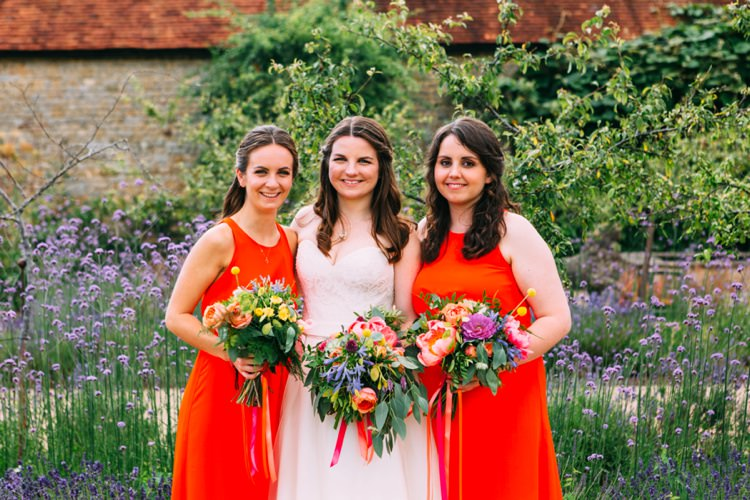 Coral Red Bridesmaid Dresses Colourful Mexican Garden Wedding http://jennifersmithphotography.co.uk/