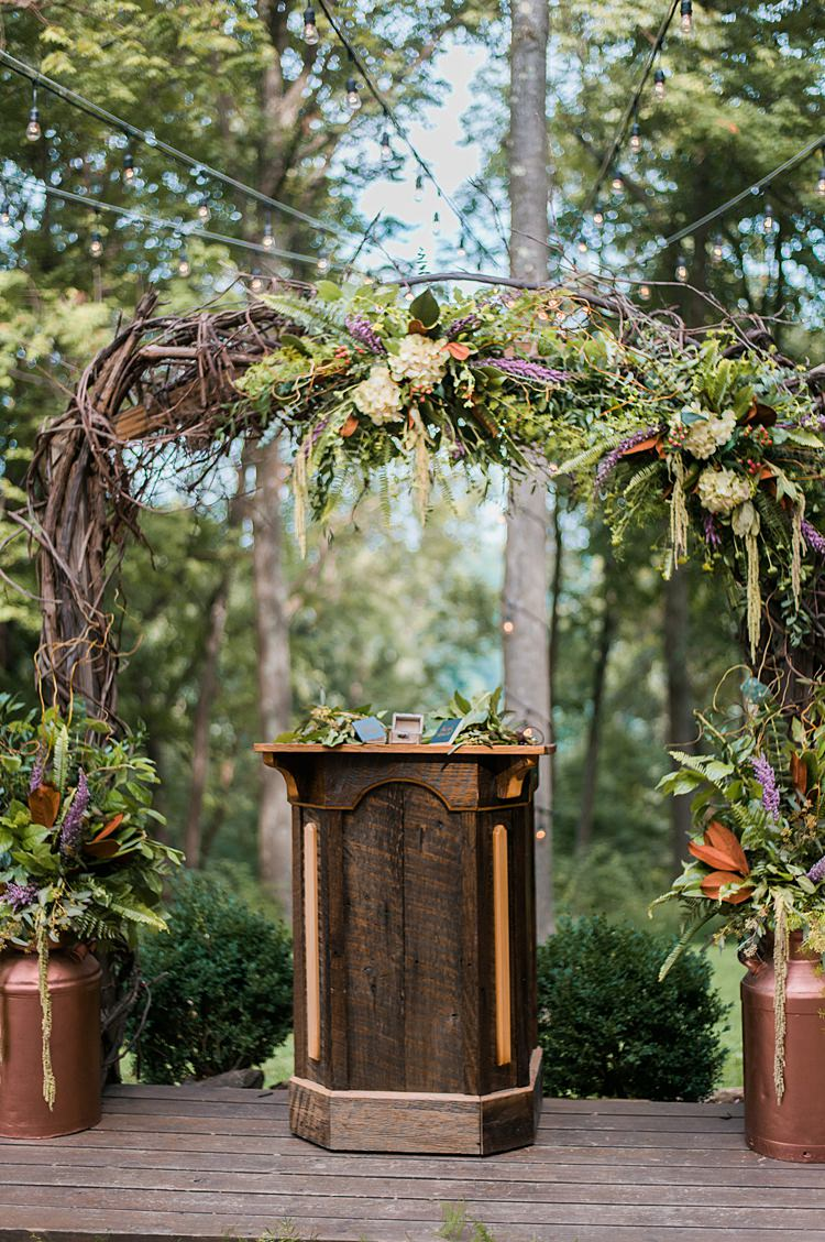 Wooden Pew Branches Foliage Outdoor Ceremony Pew Wooden Platform Whimsical Woods Wedding Barn Ohio http://www.connectionphotoblog.com/