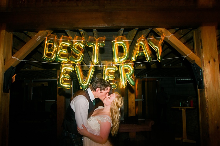 Best Day Ever Balloons Bride Groom Kiss Whimsical Woods Wedding Barn Ohio http://www.connectionphotoblog.com/