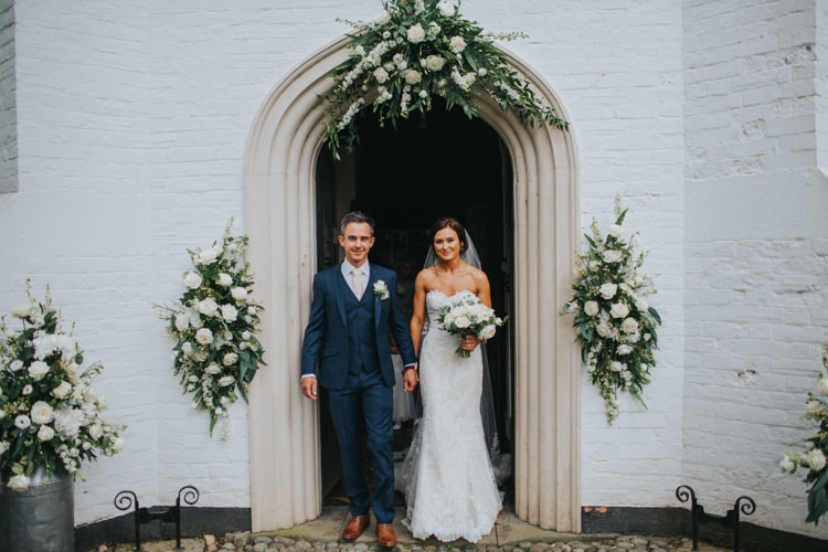 Bride Bridal Pronovias Strapless Sweetheart Fishtail Train Veil White Rose Bouquet Navy Suit Groom Church Display Floral Arrangements Chic Romantic Florals Candlelight Wedding http://lisawebbphotography.co.uk/