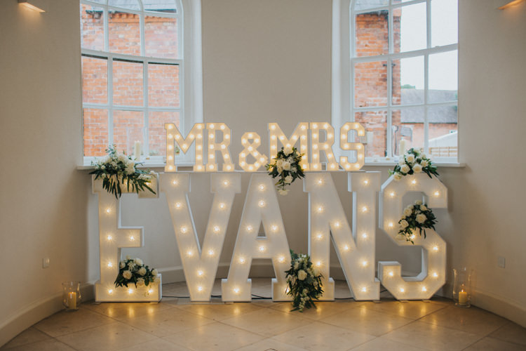 Light up Letters Mr & Mrs Circus Bulb White Roses Greenery Chic Romantic Florals Candlelight Wedding http://lisawebbphotography.co.uk/