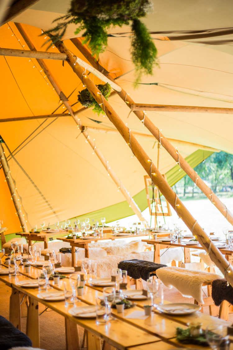 Fairy Lights Greenery Sheepskin Benches Natural Outdoor Tipi Wedding https://www.ad-photography.co.uk/